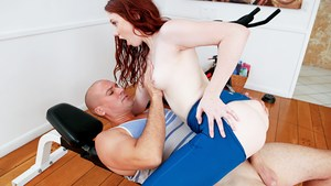 Young redhead in Yoga pants works her muscles and dick sucking skills